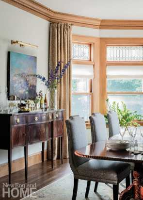 : The dressed-up dining room sports new crown molding, and dining chairs from Vanguard Furniture accompany the owner's existing table.
