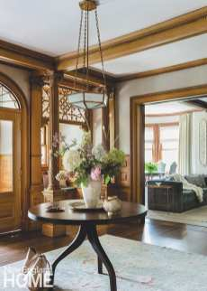 LeBlanc chose a sleek midcentury modern table to complement, not compete with, the foyer's elaborate woodwork.