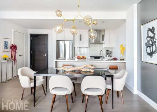 Neutral colored kitchen and dining room Boston high-rise.