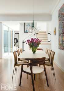 neutral dining room with contemporary art