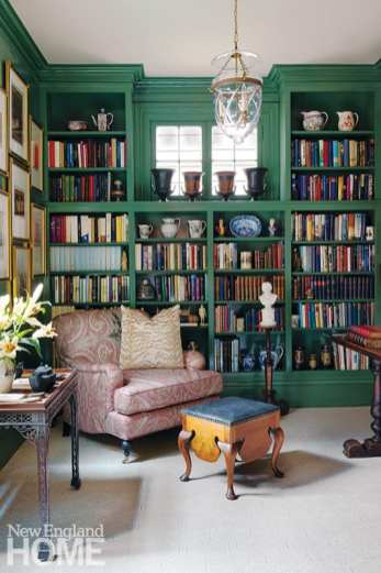 Forest-green walls give the library, James Schibanoff's favorite room in the house, a cocoon-like feeling.