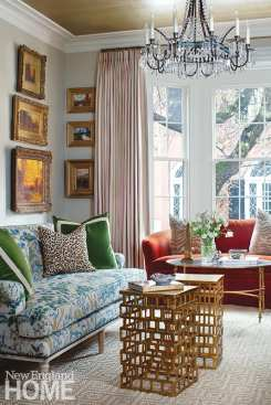 A scarlet velvet loveseat and a floral linen sofa make an unexpected but lovely pairing.