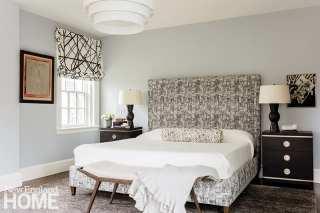 Main bedroom with patterned custom headboard