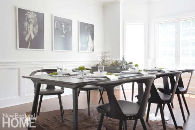 neutral dining room with photographs of actresses