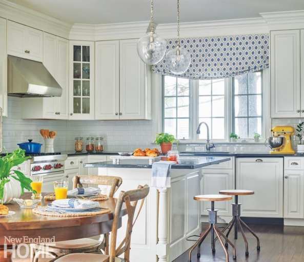 White kitchen with blue and white roman shade