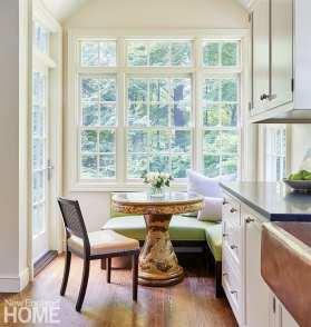 Small breakfast nook in white kitchen.