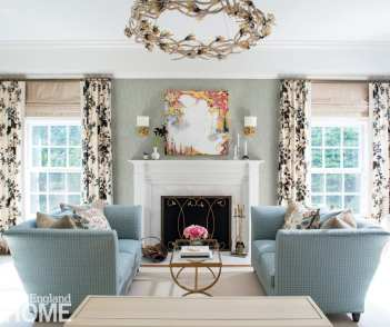 """In the bedroom's sitting area, a wallcovering from Fabricut plays off the Schumacher curtain fabric. """"The drapery drives the color and pattern in each room,"""" says Walsh."""