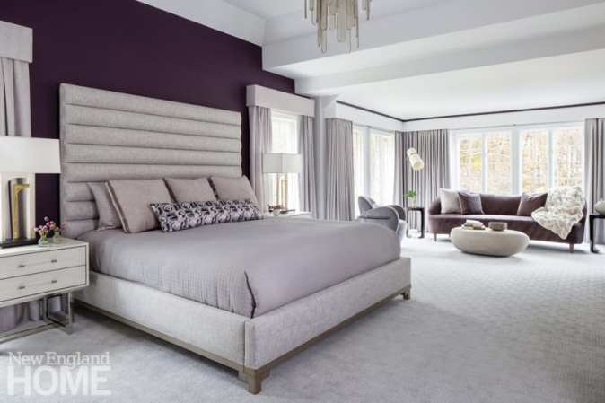 In the main suite, Rapp chose a large-scale headboard and an aubergine accent wall to anchor the space; a cozy sitting area is defined by soft, organic shapes.