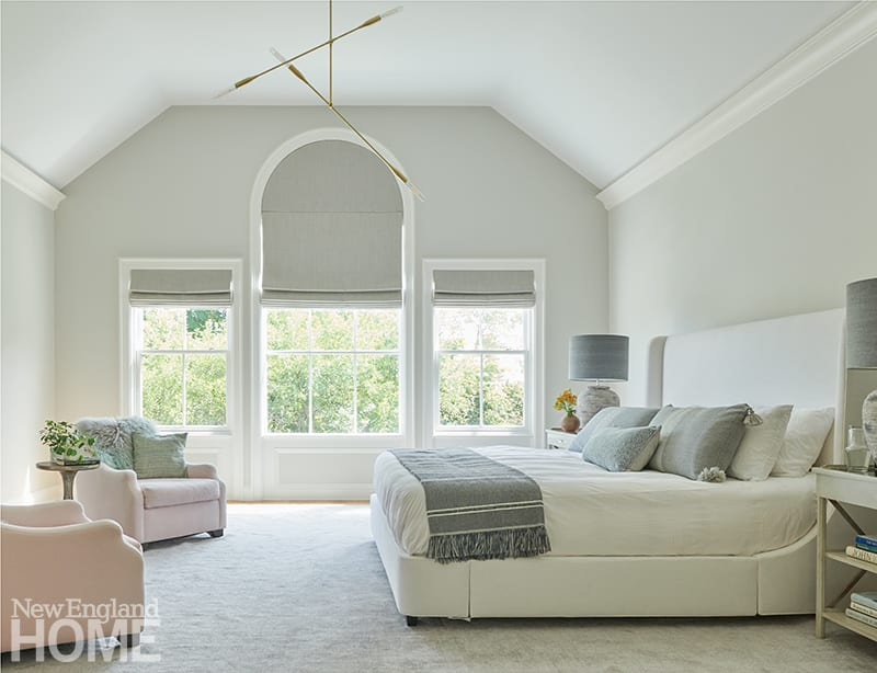 A Palladian window floods the peaceful main bedroom with light. Come nightfall, gray linen blinds by Designer Upholstery of Westport offer cocoon-like warmth.