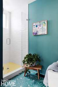 Turquoise bathroom with white tiled shower