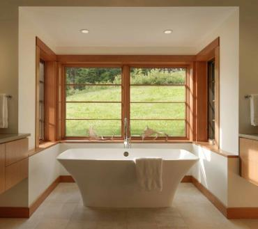 A bathroom with a view is a spa-like retreat tucked away from the hustle and bustle of a busy family home. Photo by Susan Teare.