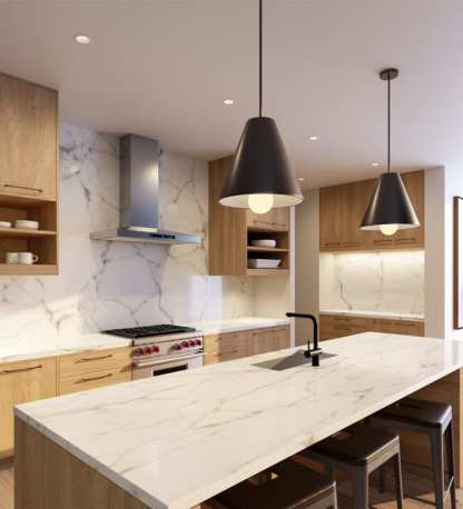 """A proper kitchen lighting plan balances function and beauty. Joni Pendants by Tech Lighting illuminate the kitchen island while Tech Lighting's (Entra CL), 3"""" Round Flanged lighting adds task lighting where it is needed most."""