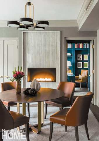 Game room with a round table and contemporary fireplace