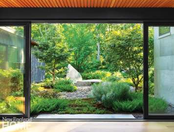 Large glass window over looking contemporary garden.