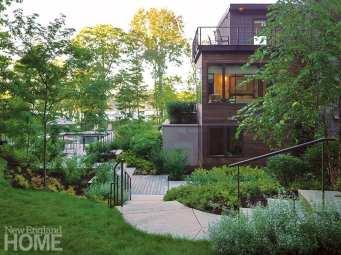 Contemporary coastal Maine home with gardens. Side view.