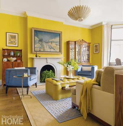 Because her clients enjoy cocktails after work, interior designer Kristen Rivoli custom designed an ottoman to feature a clever pull-out drink tray. The ottoman is covered in Spinneybeck chartreuse leather to echo the Benjamin Moore Gibson Gold walls.