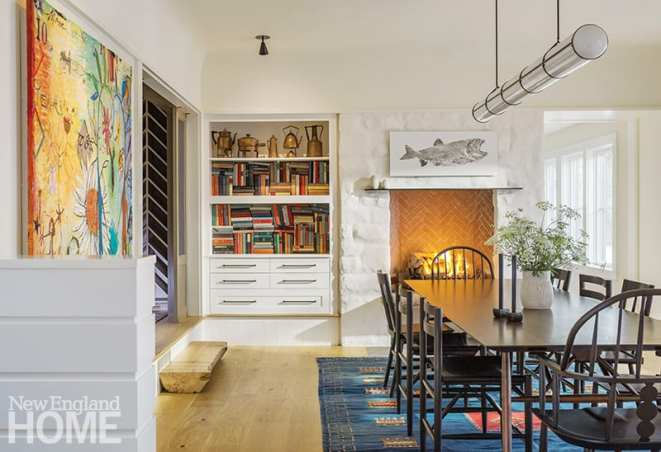 Books that belonged to the original owners fill the dining room shelves, and a rice-paper print of a lake trout caught by the homeowners' son hangs above the fireplace.