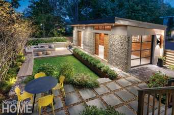 """As landscape architect Rob Gilmore's initial carport design progressed, it became a fully enclosed building. """"The lifted roof makes it feel like a place that wants to host you,"""" architect Sarah Walker says. Turner Steel Co. fabricated the Corten steel planter, which Gilmore filled with hoogendorn holly."""