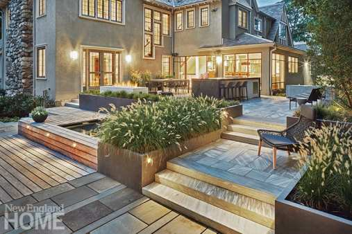 """The goal was to connect indoor and out,"""" landscape architect Stephanie Hubbard says of this backyard redesign, which includes a spa nestled into two blackened-steel planters."""