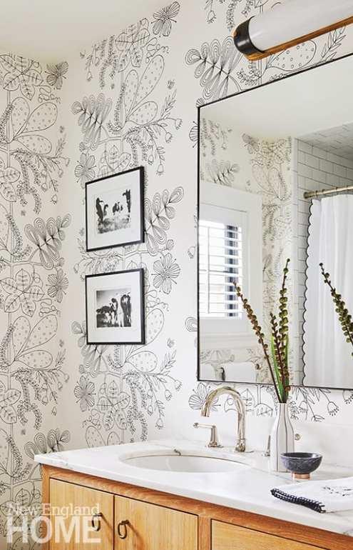 A daughter's bathroom sports a playful Schumacher wallpaper.