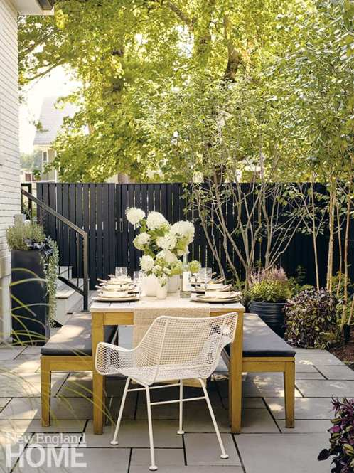 Landscape architect Terry Kinsler created a series of patios that flow from the side of the house to the back.