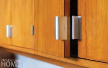 The kitchen cabinetry showcases original Herman Miller signature hardware.