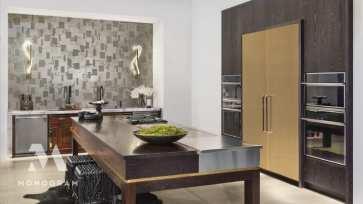 Minimalist kitchen featuring Monogram appliances