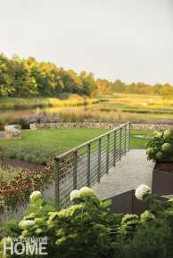 Foot bridge with aa galvinized-steel and cable railing.