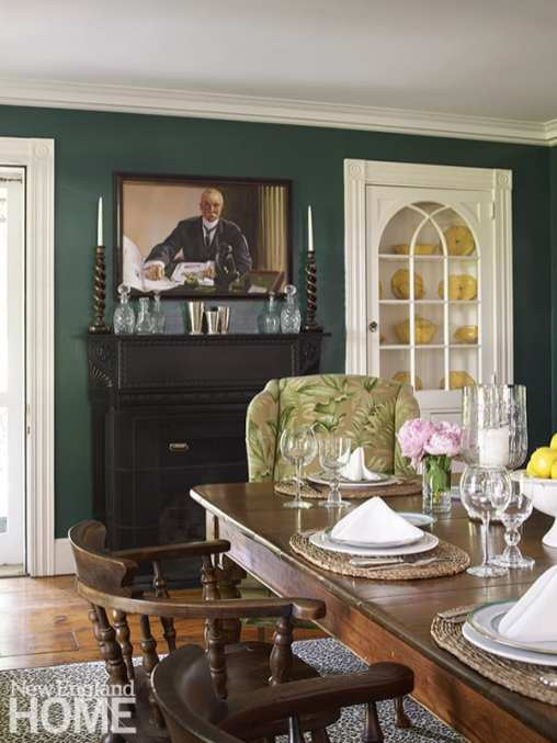 Dining room with dark green walls.