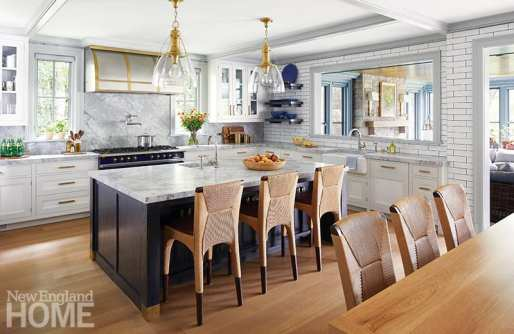 Gray and white kitchen with brass accents.