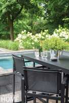 The bluestone patio includes dining space furnished with RH and a built-in spa.