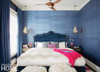 Primary bedroom with blue grasscloth wall covering.