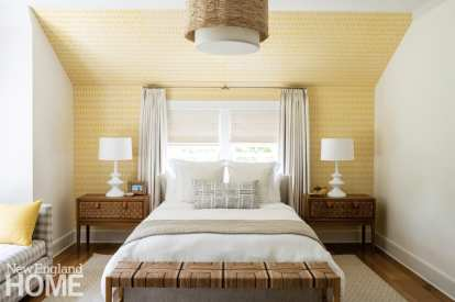 Guest bedroom with yellow walls.