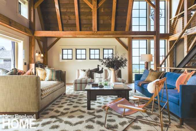 Barn living room with exposed wood beams and global textiles.