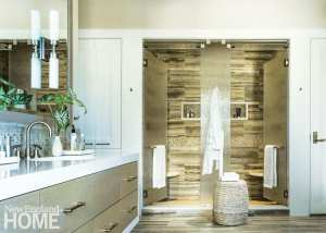 White and beige transitional style bathroom with large glass shower.