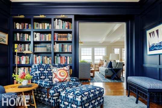 Dark blue paneled room.