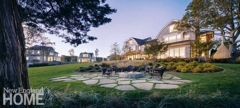 Landscape architect David Hawk says finding spots on the property to create special moments, like the firepit area he tucked into the sloping back lawn, made this project especially fun. Architect Thomas Catalano designed (from left to right) a guesthouse, a two-story building with a lounge on the first floor and an office above, a pool cabana, and the main house.