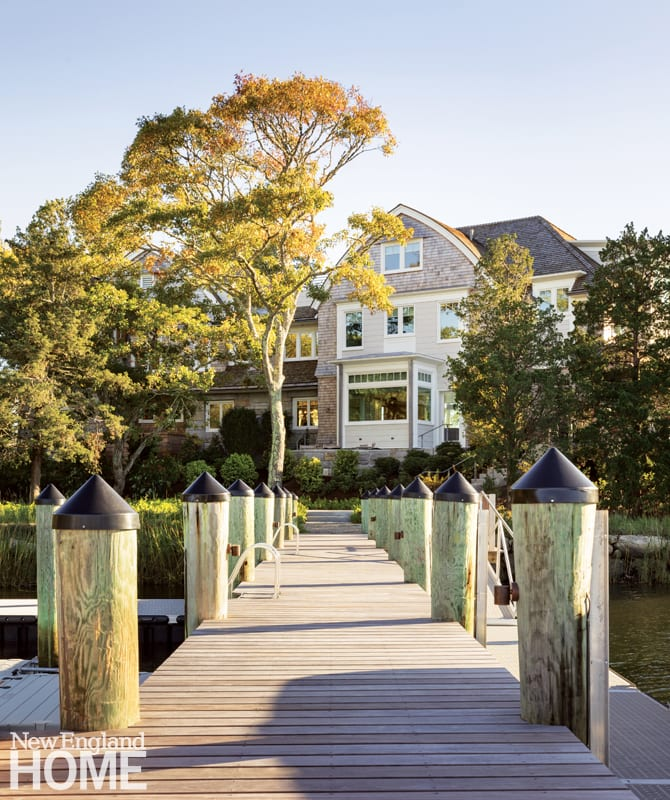 The dock is the center of plenty of water-based family fun. The bay that juts out from the house holds the kitchen's sunny breakfast area.