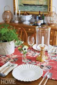 Dining table with red floral runner