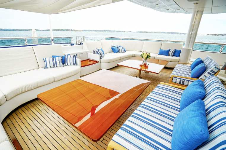Yacht installation featuring Perennial outdoor fabric on cushions and pillows. Design by Living Swell Marblehead.