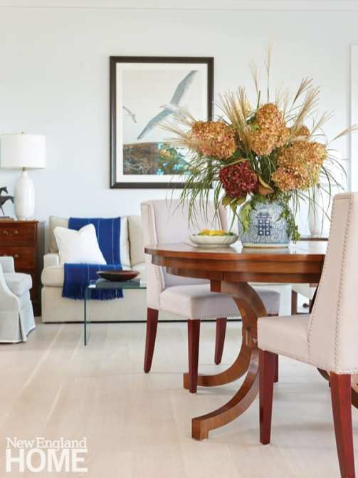 Elegant living and dining area with rift-oak floors