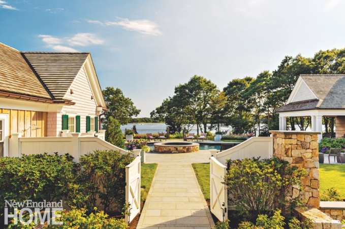 """For this secluded family paradise on a private Cape Cod island, landscape architect Michael Coutu laid two shades of granite paving around the pool and spa. The granite keeps feet cool during the heat of summer. """"It has that barefoot-on-the-island feeling,"""" says Coutu."""