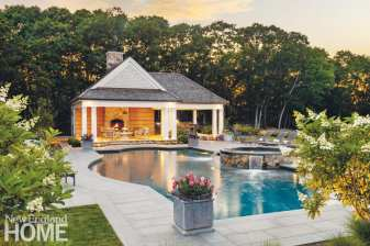 The home boasts two grilling areas, one on the patio and a second at the pool house, where a New England Fieldstone fireplace provides warmth after the sun sets.