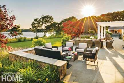 """The home's patio is a favorite spot for entertaining; """"A regular night in the summer has us with ten-plus around the dinner table,"""" says the wife."""