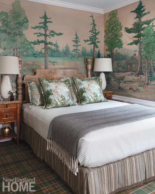 Bedroom with landscape mural and antique bed.