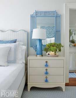 White nightstand with tassel pulls