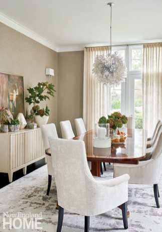 Elegant dining room with an antique table and contemporary chandelier.