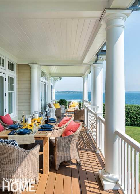 The broad back porch holds often-used dining and sitting areas.