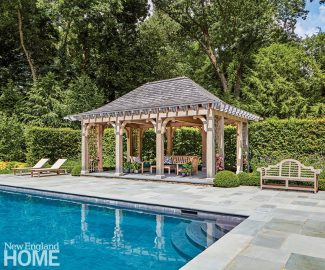 A hornbeam hedge and a canopy of mature trees provide privacy. To offset the pergola from the pool area, it's slightly raised, and the bluestone patio takes on a basket-weave pattern.