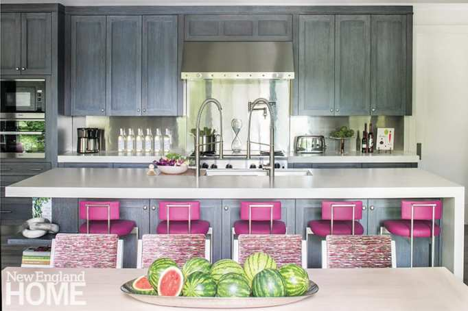 Kitchen with pink stools.